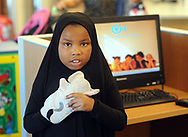 "Aminah Hucks holds onto a puppet handed to her by  volunteer, and Penn Memory Center patient Leslie Wolff (NOT SHOWN) who entertains children with the puppets Tuesday, September 05, 2017 at CHOP Care Network in Philadelphia, Pennsylvania. The Penn Memory Center, which serves people with dementia mild cognitive disorder, has a new volunteer partnership with CHOP. Its patients and ""normal controls"" volunteer with CHOP patients. (WILLIAM THOMAS CAIN / For The Philadelphia Inquirer)"