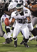 CANTON, OH - AUGUST 6:  Running back Bruce Perry #35 of the Philadelphia Eagles fumbles one of two times in the game against the Oakland Raiders during the AFC-NFC Pro Football Hall of Fame Game at Fawcett Stadium on August 6, 2006 in Canton, Ohio. The Raiders defeated the Eagles 16-10. ©Paul Anthony Spinelli *** Local Caption *** Bruce Perry