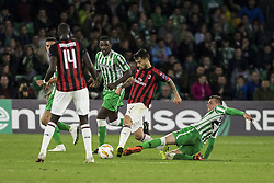 November 8, 2018 - Seville, Spain - SUSO of Milan (C) vies for the ball with GIOVANI LO CELSO (R) during the Europa League Group F soccer match between Real Betis and AC Milan at the Benito Villamarin Stadium (Credit Image: © Daniel Gonzalez Acuna/ZUMA Wire)