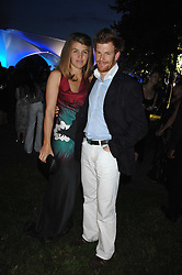 TOM AIKENS and his wife AMBER at the annual Serpentine Gallery Summer Party in association with Swarovski held at the gallery, Kensington Gardens, London on 11th July 2007.<br />