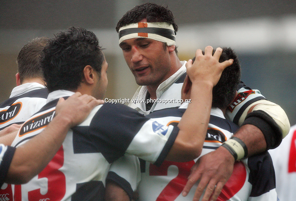 Andrew Blowers congratulates David Smith after he scored for Auckland during the Air New Zealand Cup rugby union match between Auckland and Tasman at Eden Park, Auckland, New Zealand on Sunday 6 August, 2006. Auckland won the match 46 - 6. Photo: Hannah Johnston/PHOTOSPORT<br /><br /><br /><br /><br />060806