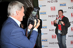 (L-R) Mark Harmon reverse roles by taking photos of Photographer Milla Cochran Agai holding up his TV Guide Magazine Cover at the TV Guide Magazine and CBS Celebrate Mark Harmon Cover & 15 Seasons Of NCIS held at the River Rock at Sportsmen's Lodge in Studio City, CA on Monday, November 6, 2017. (Photo By Sthanlee B. Mirador/Sipa USA)
