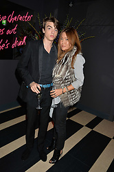 SASCHA BAILEY and MIMI NISHIKAWA at a party to celebrate the launch of the new club Charlie, 15 Berkeley Street, London on 9th September 2015.