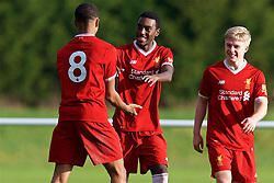 BLACKBURN, ENGLAND - Saturday, January 6, 2018: Liverpool's Rafael Camacho celebrates with team-mate Elijah Dixon-Bonner after scoring the fifth goal, to complete his hat-trick, during an Under-18 FA Premier League match between Blackburn Rovers FC and Liverpool FC at Brockhall Village Training Ground. (Pic by David Rawcliffe/Propaganda)