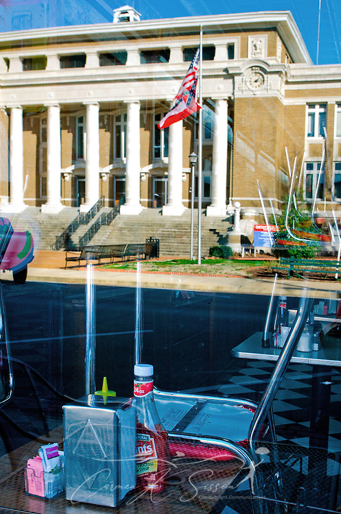 The Alcorn County Courthouse is reflected in the window of Borroum's Drug Store on Waldron Street in Corinth, Miss. Feb. 26, 2012.  (Photo by Carmen K. Sisson/Cloudybright)
