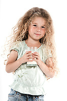 caucasian little girl portrait holding milk glass isolated studio on white background