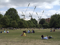 UK ENGLAND LONDON 20JUL13 - People sunbathe on a hot summer day in Kensington Gardens, west London.<br /> <br /> <br /> <br /> jre/Photo by Jiri Rezac<br /> <br /> <br /> <br /> &copy; Jiri Rezac 2013