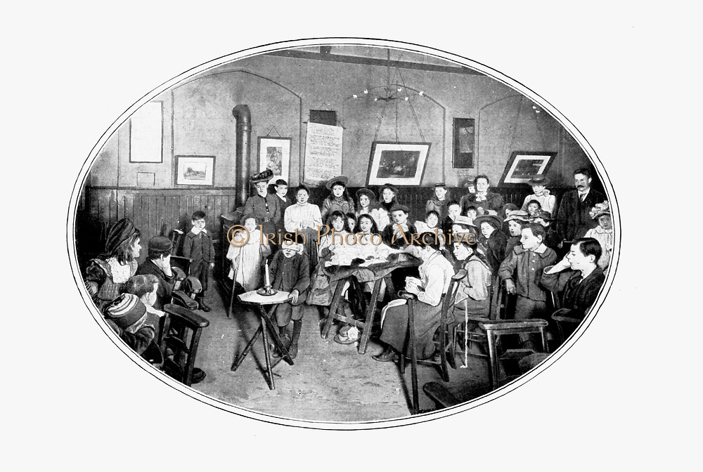 Entertaining crippled children, Browning Hall,  East London, c1910.