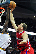 Feb. 11, 2011; Cleveland, OH, USA; Cleveland Cavaliers power forward J.J. Hickson (21) blocks Los Angeles Clippers power forward Blake Griffin (32) during the fourth quarter at Quicken Loans Arena. The Cavaliers broke their loosing streak beating the Clipper 126-119 in overtime. Mandatory Credit: Jason Miller-US PRESSWIRE