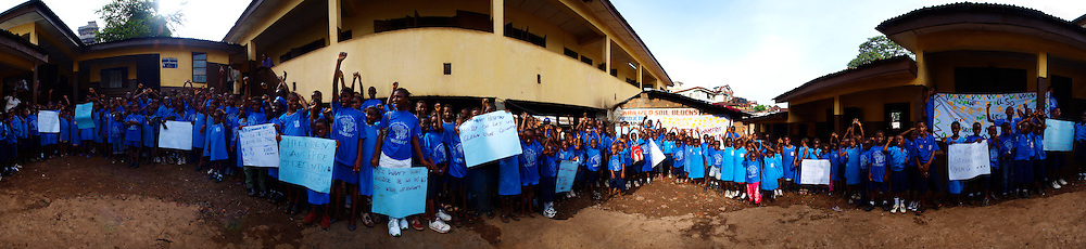 Pupils from the Fawe school prepare for a rally that will take place on June 16th 2009 for the Day of the African Child, Kroo Bay, Freetown, Sierra Leone.