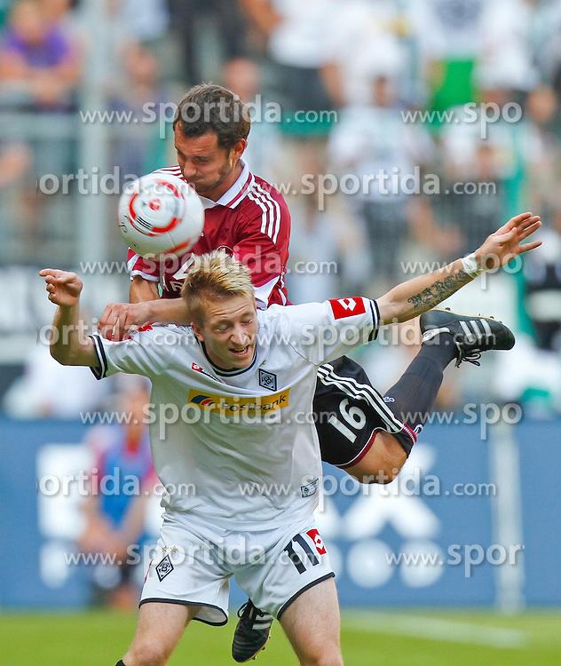 21.08.2010, Borussia Park, Mönchengladbach (Moenchengladbach), GER, 1.FBL, Borussia Mönchengladbach vs  1. FC Nürnberg (Nuernberg), im Bild: Marco Reus (Möchengladbach GER #11) vs Juri Judt (1. FC Nürnberg GER #16), EXPA Pictures © 2010, PhotoCredit: EXPA/ nph/  Scholz  +++++ ATTENTION - OUT OF GER +++++ / SPORTIDA PHOTO AGENCY
