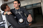 Palestinian Mustafa Majedah ,19, is carried by his friend Mohammed as they arrive for his rehabilitation session at the Artificial Limbs and Polio Center in Gaza City , December 30,2014. Mustafa lost both of his limbs during last summer's war between Israel and the militants of the Hamas-controlled Gaza Strip on July 30th when a bomb hit outside his home in Khan Younis. (Photo by Heidi Levine/Sipa Press).