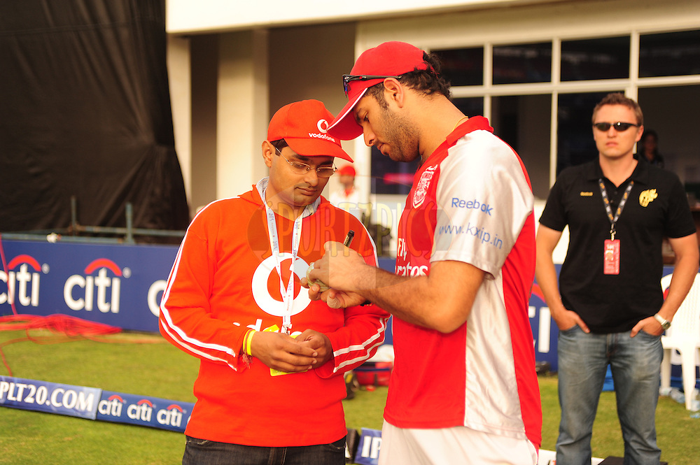 PORT ELIZABETH, SOUTH AFRICA - 3 May 2009.  Singh signing the ball during the  IPL Season 2 match between the Kolkata Knight Riders vs Kings XI Punjab held at St Georges Park in Port Elizabeth , South Africa.
