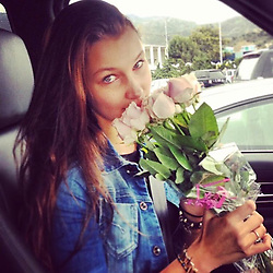 """Bella Hadid releases a photo on Instagram with the following caption: """"throwback to my 16th birthday in the parking lot of my high school \ud83e\udd8b\ud83d\udc95\ud83c\udf37"""". Photo Credit: Instagram *** No USA Distribution *** For Editorial Use Only *** Not to be Published in Books or Photo Books ***  Please note: Fees charged by the agency are for the agency's services only, and do not, nor are they intended to, convey to the user any ownership of Copyright or License in the material. The agency does not claim any ownership including but not limited to Copyright or License in the attached material. By publishing this material you expressly agree to indemnify and to hold the agency and its directors, shareholders and employees harmless from any loss, claims, damages, demands, expenses (including legal fees), or any causes of action or allegation against the agency arising out of or connected in any way with publication of the material."""