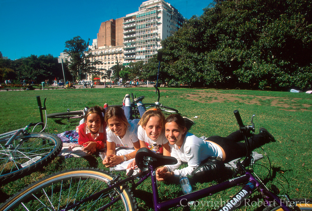 ARGENTINA, BUENOS AIRES, Recoleta, one of the city's most fashionable areas; teenage bikers rest in Plaza Alvear park