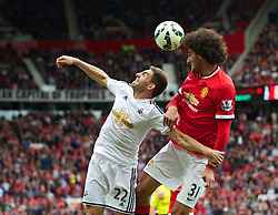16-08-2014 ENG: Premier League, Manchester United vs Swansea City, Manchester<br /> Marouane Fellaini in action against Swansea City's Angel Rangel <br /> <br /> ***NETHERLANDS ONLY***