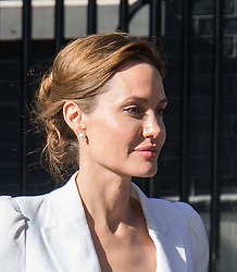 Image ©Licensed to i-Images Picture Agency. 10/06/2014. London, United Kingdom. In the frame - Angelina Jolie.<br /> Angelina Jolie meets with Prime Minister David Cameron and Foreign Secretary William Hague as part of theGlobal Summit to End Sexual Violence in Conflict global summit, at at 10 Downing Street. Picture by Nils Jorgensen / i-Images