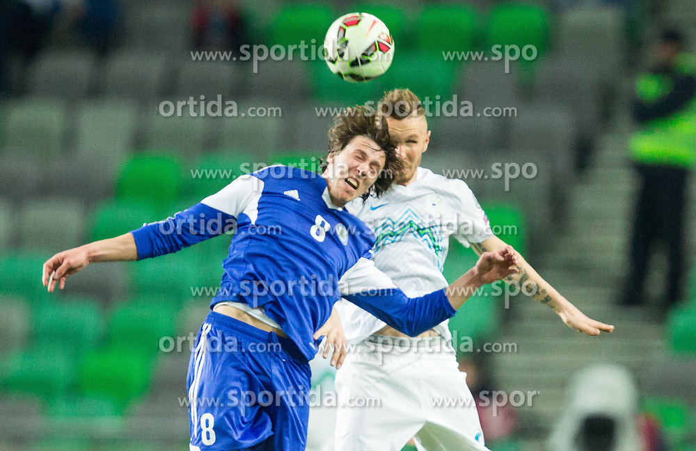 Pier Filippo Mazza of San Marino vs Jasmin Kurtic of Slovenia during football match between NationalTeams of Slovenia and San Marino in Round 5 of EURO 2016 Qualifications, on March 27, 2015 in SRC Stozice, Ljubljana, Slovenia. Photo by Vid Ponikvar / Sportida