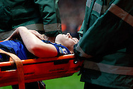 Picture by Andrew Tobin/Focus Images Ltd. 07710 761829. .21/01/12. Phil Jones (4) of Manchester United is carried off the pitch on a stretcher during the Barclays Premier League match between Arsenal and Manchester United at Emirates Stadium, London.