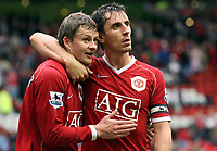 Photo: Paul Thomas.<br /> Manchester United v Newcastle United. The Barclays Premiership. 01/10/2006.<br /> <br /> Ole Gunnar Solskjaer (L) of Man Utd leaves the field happy after two goals along side captain Gary Neville.