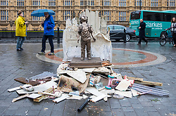 © Licensed to London News Pictures. 06/03/2018. London, UK. A statue of a child in the ruins of a house is erected opposite Parliament by Save the Children to highlight Saudi Arabia's ongoing role in the war in Yemen as Saudi Crown Prince Mohammad bin Salman visits the UK. Photo credit: Rob Pinney/LNP
