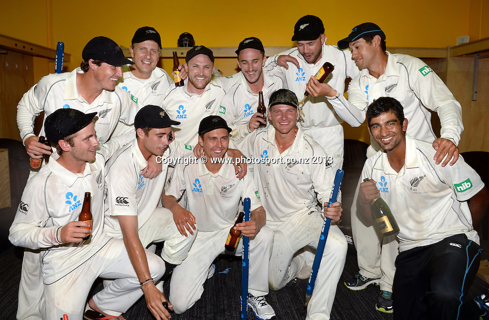 Players celebrate and pose for a team photo in the dressing room on Day 3 of the 2nd cricket test match of the ANZ Test Series. New Zealand Black Caps v West Indies at The Basin Reserve in Wellington. Friday 13 December 2013. Mandatory Photo Credit: Andrew Cornaga www.Photosport.co.nz