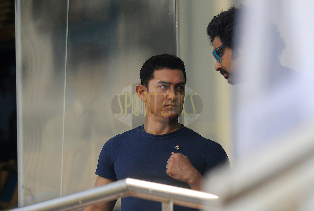 Indian Bollywood actor Aamir Khan is seen during day one of the second Star Sports test match between India and The West Indies held at The Wankhede Stadium in Mumbai, India on the 14th November 2013<br /> <br /> This test match is the 200th test match for Sachin Tendulkar and his last for India.  After a career spanning more than 24yrs Sachin is retiring from cricket and this test match is his last appearance on the field of play.<br /> <br /> Photo by: Pal PIllai - BCCI - SPORTZPICS<br /> <br /> Use of this image is subject to the terms and conditions as outlined by the BCCI. These terms can be found by following this link:<br /> <br /> http://sportzpics.photoshelter.com/gallery/BCCI-Image-Terms/G0000ahUVIIEBQ84/C0000whs75.ajndY