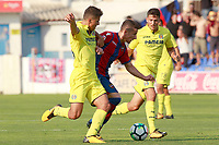 Levante UD's Enis Bardhi (c) and Villareal CF's Pau Francisco (l) and Pablo Fornals during friendly match. July 30,2017. (ALTERPHOTOS/Acero)