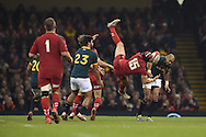 Leigh Halfpenny  of Wales is caught in a high/bad tackle from South Africa's Cornal Hendricks (r), for which the South African gets yellow carded.  Dove Men series 2014, autumn international rugby match, Wales v South Africa at the Millennium stadium in Cardiff, South Wales on Saturday 29th November 2014<br /> pic by Andrew Orchard, Andrew Orchard sports photography.