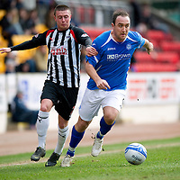 St Johnstone v Dunfermline....25.02.12   SPL<br /> Lee Croft is pulled back by Joe Cardle<br /> Picture by Graeme Hart.<br /> Copyright Perthshire Picture Agency<br /> Tel: 01738 623350  Mobile: 07990 594431