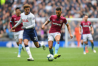 Football - 2018 / 2019 Premier League - Tottenham Hotspur vs. West Ham United<br /> <br /> West Ham United's Ryan Fredericks holds off the challenge from Tottenham Hotspur's Dele Alli, at The Tottenham Hotspur Stadium.<br /> <br /> COLORSPORT/ASHLEY WESTERN