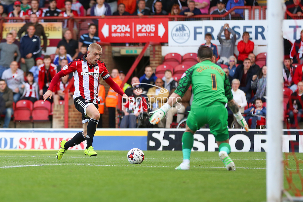 Brentford Defender Jake Bidwell about to shoot at goal during the Sky Bet Championship match between Brentford and Sheffield Wednesday at Griffin Park, London, England on 26 September 2015. Photo by Phil Duncan.