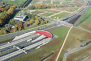 Nederland, Utrecht, Utrecht, 24-10-2013;<br /> Rijksweg A2 en de zuidelijke ingang van de  Leidsche Rijntunnel, een landtunnel die de verkeersoverlast, luchtvervuiling en geluidsoverlast voor Utrecht en de Vinexwijk Leidsche Rijn moet verminderen. Stadsbaan links van de tunnel. Stadsbaan links van de tunnel.<br /> Roadway A2 and the southern entrance to the tunnel Leidsche Rijn, a landtunnel built to decrease the nuisance of traffic noise and air pollution for the city of Utrecht and the suburb Leidsche Rijn (l) . <br /> luchtfoto (toeslag op standaard tarieven);<br /> aerial photo (additional fee required);<br /> copyright foto/photo Siebe Swart.