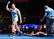 Brandon Metz of West Fargo, N.D., celebrates after winning the 220-pound Cadet Greco-Roman match against Allen Stallings for the national title Monday, July 21, 2014, at the Fargodome in Fargo.<br /> Nick Wagner / The Forum