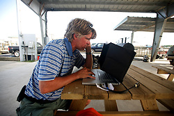 07 May 2010. Venice, Louisiana. Deepwater Horizon, British Petroleum environmental oil spill disaster.<br /> AP photographer Alex Brandon getting images out! <br /> Sport fishermen land yellow fin tuna and other predator species caught to the west of the giant BP oil spill. Nobody is sure how much longer they will be able to catch fish in the region. Charter boat captains, rental camps and hotels are reporting mass cancellations of fishing trips and other vacations to the Gulf  Coast region.<br /> Photo credit; Charlie Varley/varleypix.com