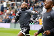 Fulham striker Sone Aluko (24) warms up before kick off  during the EFL Sky Bet Championship match between Fulham and Wolverhampton Wanderers at Craven Cottage, London, England on 18 March 2017. Photo by Andy Walter.