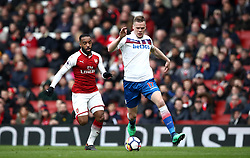 Stoke City's Ryan Shawcross (right) and Arsenal's Alexandre Lacazette battle for the ball during the Premier League match at The Emirates Stadium, London.