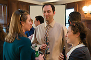 Sara Knechtel, of DC, (left) speaks with Matt Gever, DC, and Mia Green, of DC at a fundraiser March 24, 2010. The Hebrew Immigrant Aid Society (HIAS) held the fundraiser in Washington, DC., to benefit immigrants preparing to take their US Citizenship Exam.
