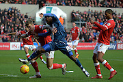 Bristol City defender Aden Flint challenges Birmingham City midfielder Jacques Maghoma during the Sky Bet Championship match between Bristol City and Birmingham City at Ashton Gate, Bristol, England on 30 January 2016. Photo by Alan Franklin.