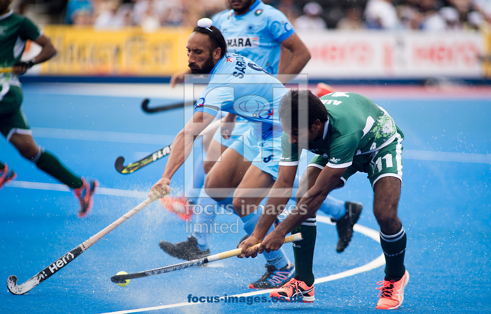 Sardar Singh of India and Ajaz Ahmad battle for the ball on day four of the Men's Hero Hockey World League Semi-Finals at Lee Valley Hockey Centre, Stratford<br /> Picture by Hannah Fountain/Focus Images Ltd 07814482222<br /> 18/06/2017