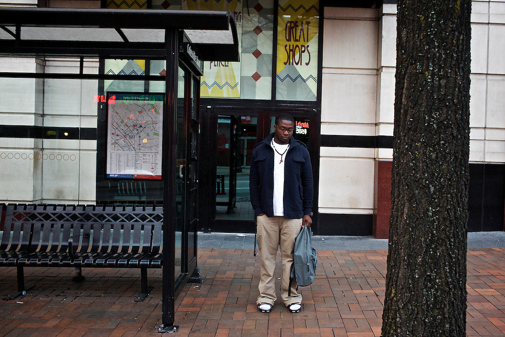 Kenneth Okorafor, 26, waits for a bus in Silver Spring, MD to take him to Montgomery College. Okorafor, who is from Nigeria, has lived with his sister and her family in the United States since 2000. He plans on returning to Nigeria after he graduates.