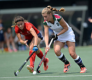 Surbiton's Sarah haycroft challenges with SPV Complutense's Lucia Jimenez  during their opening game of the EHCC 2017 at Den Bosch HC, The Netherlands, 2nd June 2017