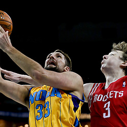 Jan 25, 2013; New Orleans, LA, USA; New Orleans Hornets power forward Ryan Anderson (33) shoots over Houston Rockets center Omer Asik (3) during the second quarter of a game at the New Orleans Arena. Mandatory Credit: Derick E. Hingle-USA TODAY Sports