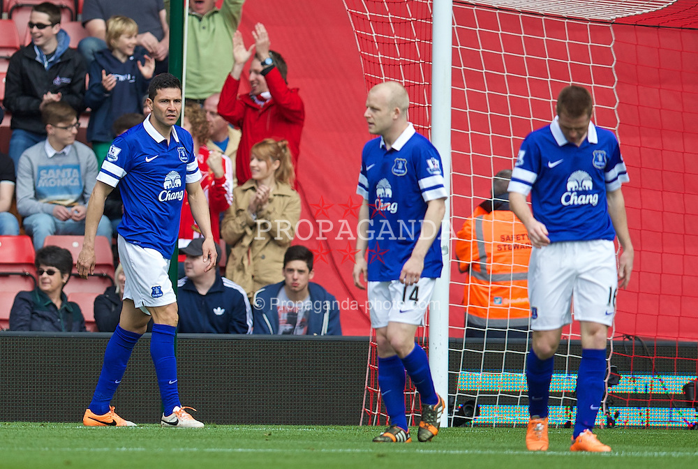 SOUTHAMPTON, ENGLAND - Saturday, April 26, 2014: Everton's Antolin Alcaraz looks dejected after scoring an own-goal against Southampton during the Premiership match at St Mary's Stadium. (Pic by David Rawcliffe/Propaganda)