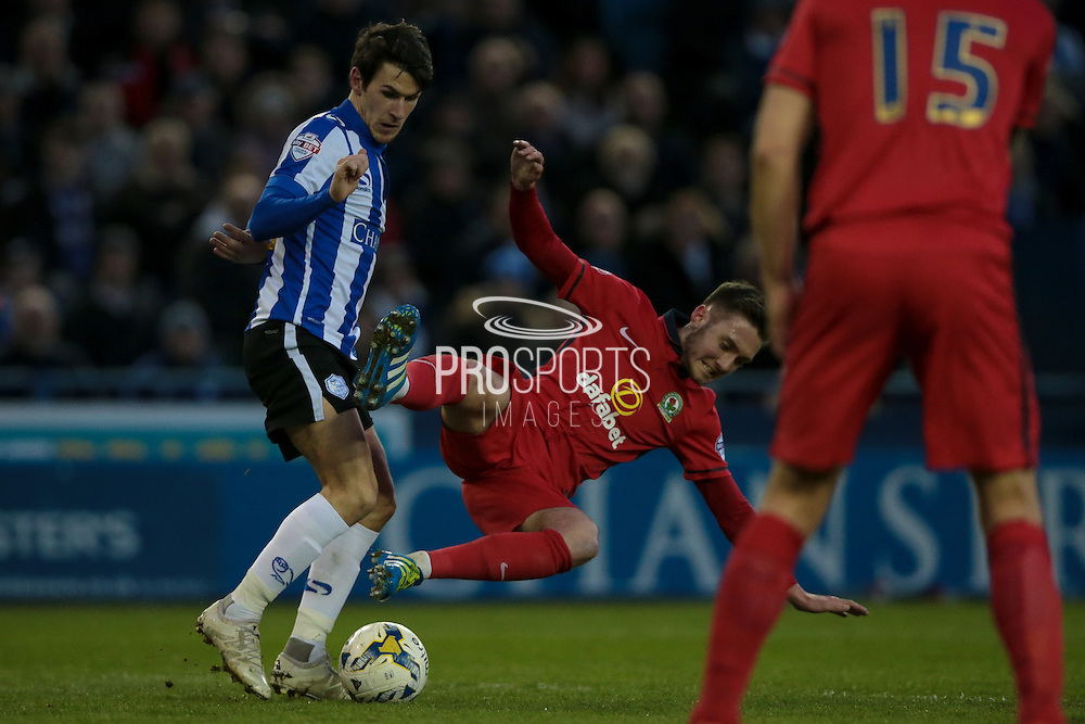 Matt Grimes (Blackburn Rovers) is sent flying by Kieran Lee (Sheffield Wednesday), but no foul during the Sky Bet Championship match between Sheffield Wednesday and Blackburn Rovers at Hillsborough, Sheffield, England on 5 April 2016. Photo by Mark P Doherty.