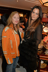 Left to right, KAREN HOWES and MOLLY MILLER-MUNDY at a party to celebrate the publication of 'A Designer's Life' by Nicky Haslam held at Ralph Lauren, 1 New Bond Street, London on 19th November 2014.