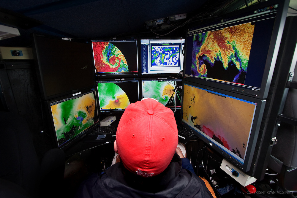 Alex Gibbs, a graduate student at the University of Nebraska, operates the computers controlling the weather radar inside the Doppler on Wheels truck in Salina, Kansas, June 3, 2009.  The DOW trucks are participating in Project Vortex 2.<br />