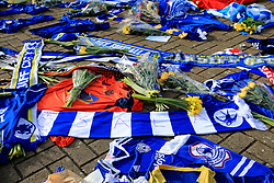 A view of flowers and scarves placed outside Cardiff City Stadium in tribute to Emiliano Sala during the Premier League match at the Cardiff City Stadium.