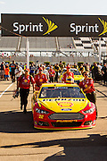 July 31, 2015: The crew of the #22 Shell Pennzoil Ford driven by Joey Logano push his car back to the garage after qualifying for the NASCAR Sprint Cup Series Windows 10 400 at Pocono Raceway in Long Pond, PA.