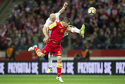 October 8, 2017 - Warsaw, Poland - Michal Pazdan of Poland and Fatos Beciraj of Montenegro during the FIFA World Cup 2018 Qualifying Round Group E match between Poland and Montenegro at National Stadium in Warsaw, Poland on October 8, 2017  (Credit Image: © Andrew Surma/NurPhoto via ZUMA Press)